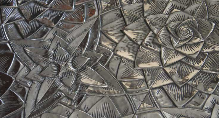 Designers who have turned to recycling aluminum transforming it into amazing artistic wall tiles.  Tiles with a tale Materials are being used in increasingly innovative ways for unique and practical design solutions 9