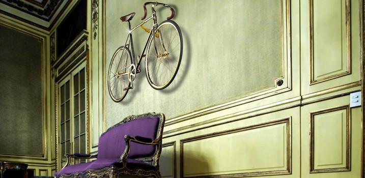 Gold bike on wall, luxury home